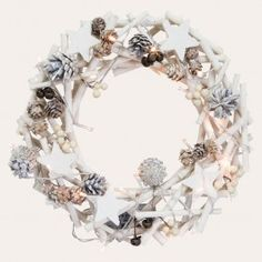 Welcome your guests with festive spirit and hang this rustic wreath on your door this Christmas. Featuring a textural mix of white twigs and stars, pine cones, bells and berries, it also has lights for a little sparkle to put you in the festive mood. You'll find it perfect for adorning a door, wall or mantelpiece year after year as a classic decoration.
