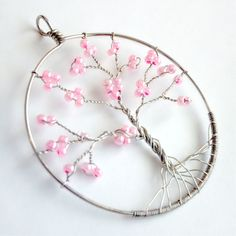 not the biggest fan of tree of life stuff, but this one is gorgeous. I'm a sucker for sakura. Tree Of Life Jewelry, Tree Of Life Necklace, Tree Of Life Pendant, Handmade Wire Jewelry, Wire Wrapped Jewelry, Wire Crafts, Jewelry Crafts, Wire Tree Sculpture, Silverware Jewelry