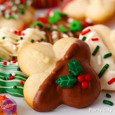 Make Santa happy with Christmas cookies dipped in Candy Melts and artfully decorated with holiday sprinkles! Click for more easy melted candy Christmas cookies ideas!