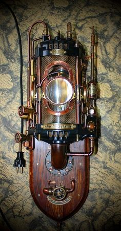 A steampunk light source Chat Steampunk, Lampe Steampunk, Style Steampunk, Steampunk Gadgets, Steampunk Crafts, Steampunk House, Steampunk Design, Steampunk Fashion, Steampunk Font