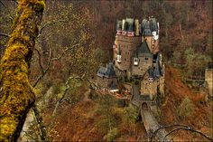 Burg Eltz is a medieval castle nestled in the hills above the Moselle River between Koblenz and Trier, Germany. It is still owned by a branch of the same family that lived there in the 12th century, 33 generations ago.