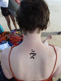 A henna Balinese Om.