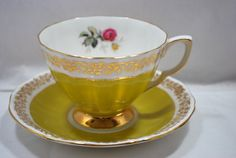 Gold Tea Cup and Saucer Yellow and Gold by Dupasseaupresent