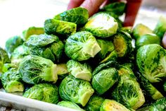 showing how to make Brussels Sprouts recipe in oven by tossing sprouts with seasonings Roast Recipes, Oven Recipes, Vegetable Recipes, Cooking Recipes, Veggie Meals, Balsamic Brussel Sprouts, Roasted Sprouts, Brussels Sprouts, Healthy Meal Prep