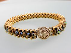 Gold Tennis Bead Bracelet with Fire Polish Beads by Dajamana, $75.00