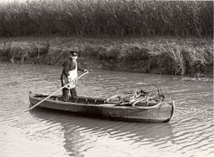 Wisbech - postman delivering by boat 1937 . .I HOPE YOU'LL FOLLOW ANY OF MY 5 GREAT BOARDS CONCERNING THE POST OFFICE MAILMEN VEHICLES MAILBOXES AND OTHER THINGS