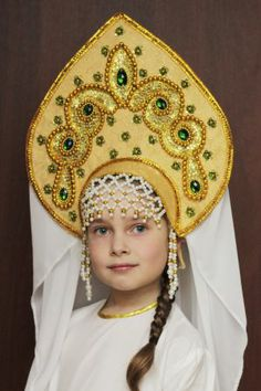 "A pretty girl in the Russian national headdress ""Kokoshnik"