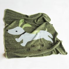 love this puppy throw for baby miles, to match the dog print in the nursery! so sweet.