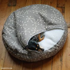 This DIY Burrow Dog Bed is great for dogs who love to tunnel! Learn how to make your own via Lia Griffith. Or you can purchase burrow dog beds online here: Homemade Pet Beds, Diy Dog Bed, Diy Bed, Pet Beds Diy, Animal Projects, Diy Stuffed Animals, Dog Accessories, Dog Care, Dog Toys