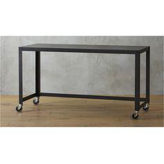 Shop go-cart carbon rolling console table.   Nifty metal office worker or dining companion rolls into place on 4 commercial wheels and 1 industrial carbon grey powdercoat.  2 wheels lock.