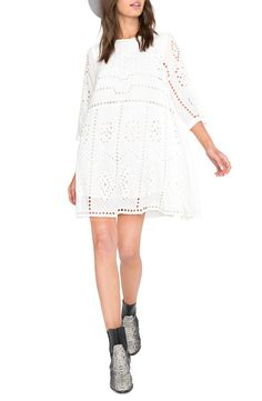 Abbreviated sleeves and a loose, swingy fit enhance the airy, easygoing vibe of this eyelet lace shift. #nordtrom @nords