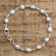 Novica Romantic Aura Oval White Freshwater Pearls Bezel Set in 925 Sterling Adjustable Length Womens Bracelet