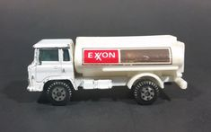 Vintage Yatming White Exxon Semi Oil Gasoline Tanker Truck Diecast Toy https://treasurevalleyantiques.com/products/vintage-yatming-white-exxon-semi-oil-gasoline-tanker-truck-diecast-toy #Vintage #Yatming #White #Exxon #Semis #Oil #Companies #Gas #Gasoline #Petrol #Petroleum #Tankers #Trucks #Diecasts #Cars #Collectibles #Toys #Autos #Automobile #Vehicles #Garage #Decor