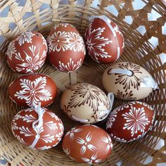 Drop-Pull Pysanky Eggs. Looks like a curved upholstery needle was used to add the ribbon to the egg after boring holes in at appropriate distance apart using a Pysanka tool. This crafter used melted wax crayons as embellishment instead of beeswax then a dye bath.