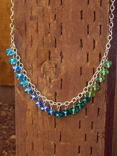 Learn how to make a beaded necklace with this jewelry tutorial. This lesson teaches you how to make wrapped loops, attach the beads, and put a clasp on chain.