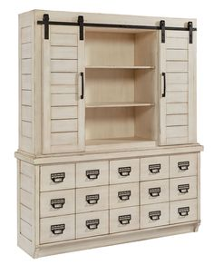 The hutch, with its sliding barn styled doors and black metal tracks, adds a great nostalgic look to any room. Combined with the utility cabinet style of the buffet, it will give your home a unique character.