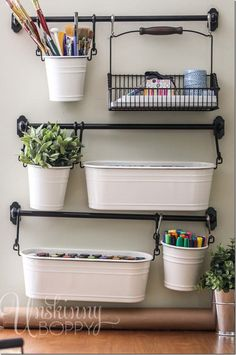 Get organized and hang craft considers from towel bars. In an array of bins, markers, brushes, and even a happy little plant all have a home together.