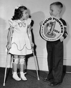 1954-polio vaccine---This little girl is wearing two long leg braces. I wore only one on the left leg, notice her shoes are a pretty white.  By the time I had polio and needed shoes only brown was provided for me.