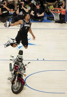 Minnesota Timberwolves' Derrick Williams jumps over a motorcycle during the NBA basketball All-Star Slam Dunk Contest in Orlando, Fla., Saturday, Feb. 25, 2012. (AP Photo/Chris O'Meara)