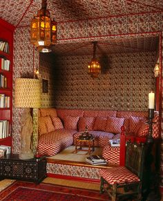 red paisley and other patterns vie for attention in this cozy English library