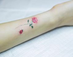 Small pink rose and ladybug tattoo on the inner forearm. Rose Stem Tattoo, Finger Rose Tattoo, Pink Rose Tattoos, Finger Tattoos, Mom Tattoos, Little Tattoos, Cute Tattoos, Tattoos For Women, Tatoos