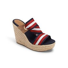 """Tommy Hilfiger women's shoe. Simply American – step out in style in our patriotic wedge wrapped in braids.• Wedge sandal with cotton and leather upper. • 4"""" heel, padded insole, rubber outsole.• Imported."""
