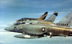 North American F-100D Super Sabres of the 481st Tactical Fighter Squadron over South Vietnam in February 1966. Early F-100s were unpainted when they arrived in Southeast Asia like the foreground aircraft, but all eventually received camouflage paint like the aircraft in the back. (U.S. Air Force photo)