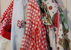 holiday aprons hanging in the kitchen