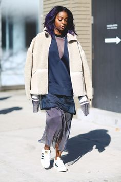 Lessons In Layering From The Streets Of New York City #refinery29  http://www.refinery29.com/2016/02/103173/ny-fashion-week-fall-winter-2016-street-style-pictures#slide-120  Get bold with your textures. Shearling over mesh feels fresh and unexpected. ...