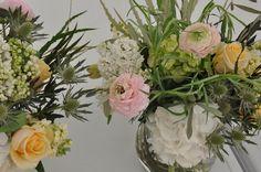Love the mix of foliage & flower choice: Ranunculus, hydrangea, rose, grevillea, olive