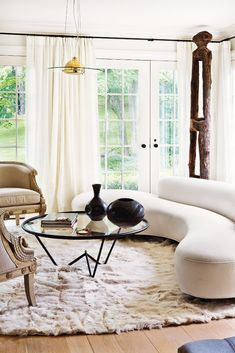 This Amazing Home is a Lesson in Sophisticated Décor// round coffee table, curved sofa, wood sculpture, Gustavian chairs Living Room Designs, Living Spaces, Living Rooms, Curved Sofa, Furniture Styles, Living Room Inspiration, Architectural Digest, Apartment Design, Designer
