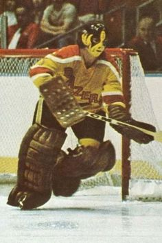 WHA Philly Blazers relocated to form the Vancouver Blazers to Red, yellow & orange. in 1975 the team moved to form the Calgary Cowboys. Stars Hockey, Women's Hockey, Hockey Stuff, Nhl, Hockey Rules, Ice Hockey Players, Goalie Mask, Masked Man, Star Wars
