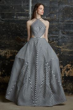 "Two historical styles dominate this dress. The first is a crinoline shape, giving a stiff fullness, popular in the late 1800s. The second influence is Op Art from the 1960s. Lines on her dress gives the illusion of movement along her body with bust and waist focal points. 3/29/15. ""Rosie Assoulin F/W 2015, New York Fashion Week """