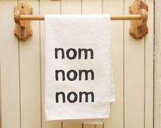 I need to make these teatowels!! Alex always says NOM NOM NOM when she wants something to eat!
