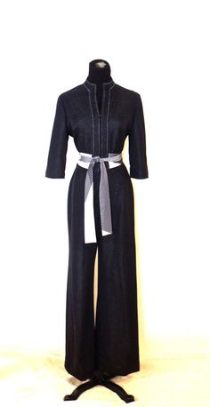 A personal favorite from my Etsy shop https://www.etsy.com/listing/465619072/vintage-belted-jumpsuit-1960s-70s