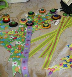 Easy to make Bazaar craft - ribbon and button bookmarks.  Stack and sew colorful buttons on one end of printed ribbon.  Good Girl Scout project?