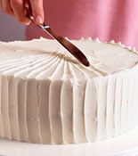 cake decorating tip: using the side of the knife ( Can make the wedding cake myself this way with mini cupcake around it )
