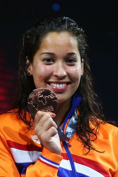 Bronze medal winner Ranomi Kromowidjojo of the Netherlands celebrates on the podium after the Swimming Women's Butterfly 50m Final on day fifteen of the 15th FINA World Championships at Palau Sant Jordi on August 3, 2013 in Barcelona, Spain.
