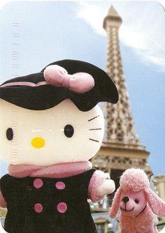 Parisian Hello Kitty with a pink poodle at the Eiffel Tour -- c'est si bon!