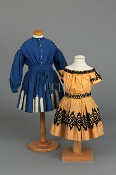 Dress, 1860-1870 and Two-piece Dress, 1865-1870 ..The Civil War profoundly affected people and its influence is reflected in clothing. Women and children's clothing was enhanced with tassels, braid, and buttons inspired by men's military uniforms. This blue wool ensemble features military-inspired embellishments made popular during the Civil War. Boys donned military-inspired clothing in support of the cause for which their male family members fought.y