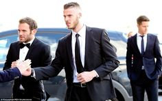 David de Gea (centre) arrives at the Manchester United end-of-season awards dressed in a smart black suit alongside team-mate Juan Mata