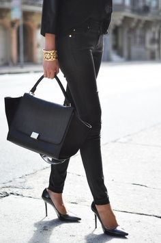 From fashgasmic.tumblr.com. love the skinny black pointy heels, all black outfit, @Victoria McCoy Burch cuff