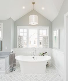 The master bathroom features a classic grey and white color scheme traditional bathroom vanities australia traditional bathroom accessories White Master Bathroom, Grey Bathrooms, Modern Bathroom, Neutral Bathroom, Master Master, Luxury Bathrooms, Bathroom Trends, Bathroom Spa, Small Bathroom