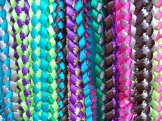 Im making these for the girl scouts bridging ceremony.  Green and white to represent Junior girl scout colors.  How to make Hawaiian Ribbon Leis - Use school colors & give away on graduation day.