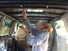 Custom RV Camper Van Stealth Conversion Van we built to be totally off grid with solar power and 25G freshwater tank.  Built into a 2005 Chevrolet Astro Van by my husband and I.   Bug out vehicle!  Here you see early in the build when the interior has been stripped out to remove excess weight and to put insulation in. The huge hole in the roof will be for our Fan-Tastic RV vent fan. In this pic I'm treating the raw metal with rustoleum paint to prevent rust