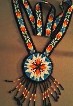 Native American Beaded Rosette Necklace, Beaded Pendant, with Loom Beaded Neckstrap, Fringed Necklace  via Etsy   $65.00