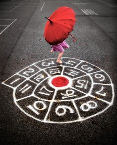 Games such as hopscotch and the one pictured help develop a 3-5 year old's gross motor skills. By jumping on one foot and spinning around, a child learns their centre of gravity and their sense of balance.