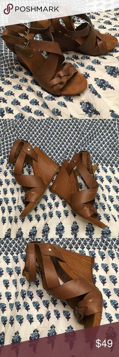 Super comfy Brown Leather and Wooden 9 West Wedge Super comfy Brown Leather and Wooden 9 West Wedge with 4 1/2 in heel. Too tall for me to wear after breaking ankle. Nine West Shoes Wedges