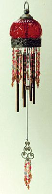 "Burgundy Wind Chime: An ethereal tinkle carried on a breeze conjures a peaceful bliss that transcends daily cares. Burgundy etched glass, hand-strung beads with ornate findings and embellishments. 18""."