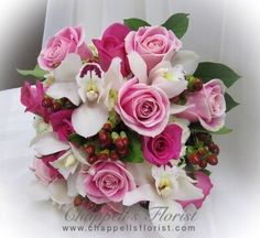 Bride's Bouquet – White Cymbidium Orchids, Red Hypericum, Deep Pink and Pale Pink Roses.